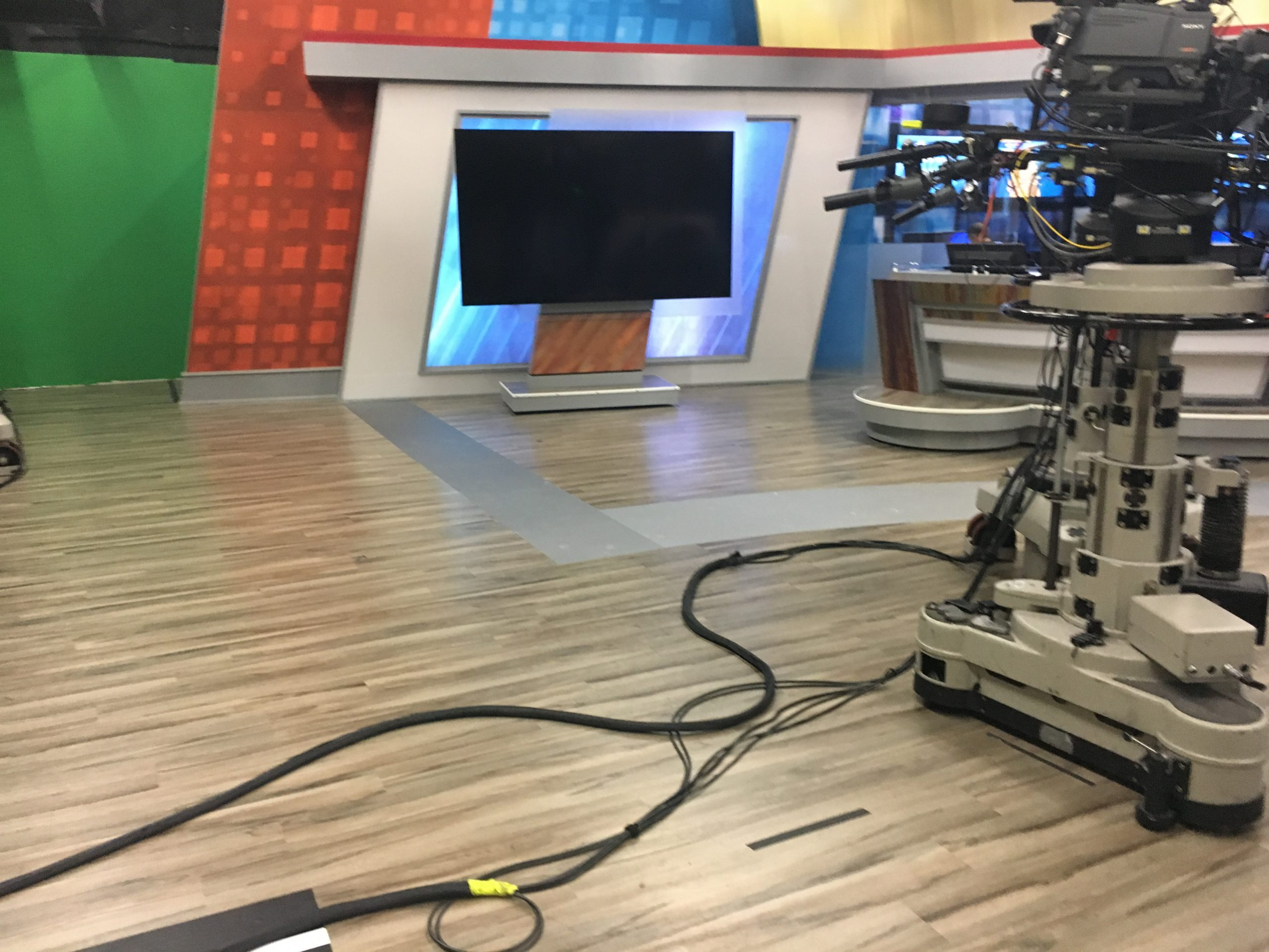Wesh Studio flooring with camera and television