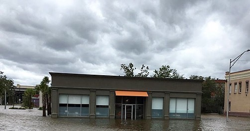 Commercial building with flood waters