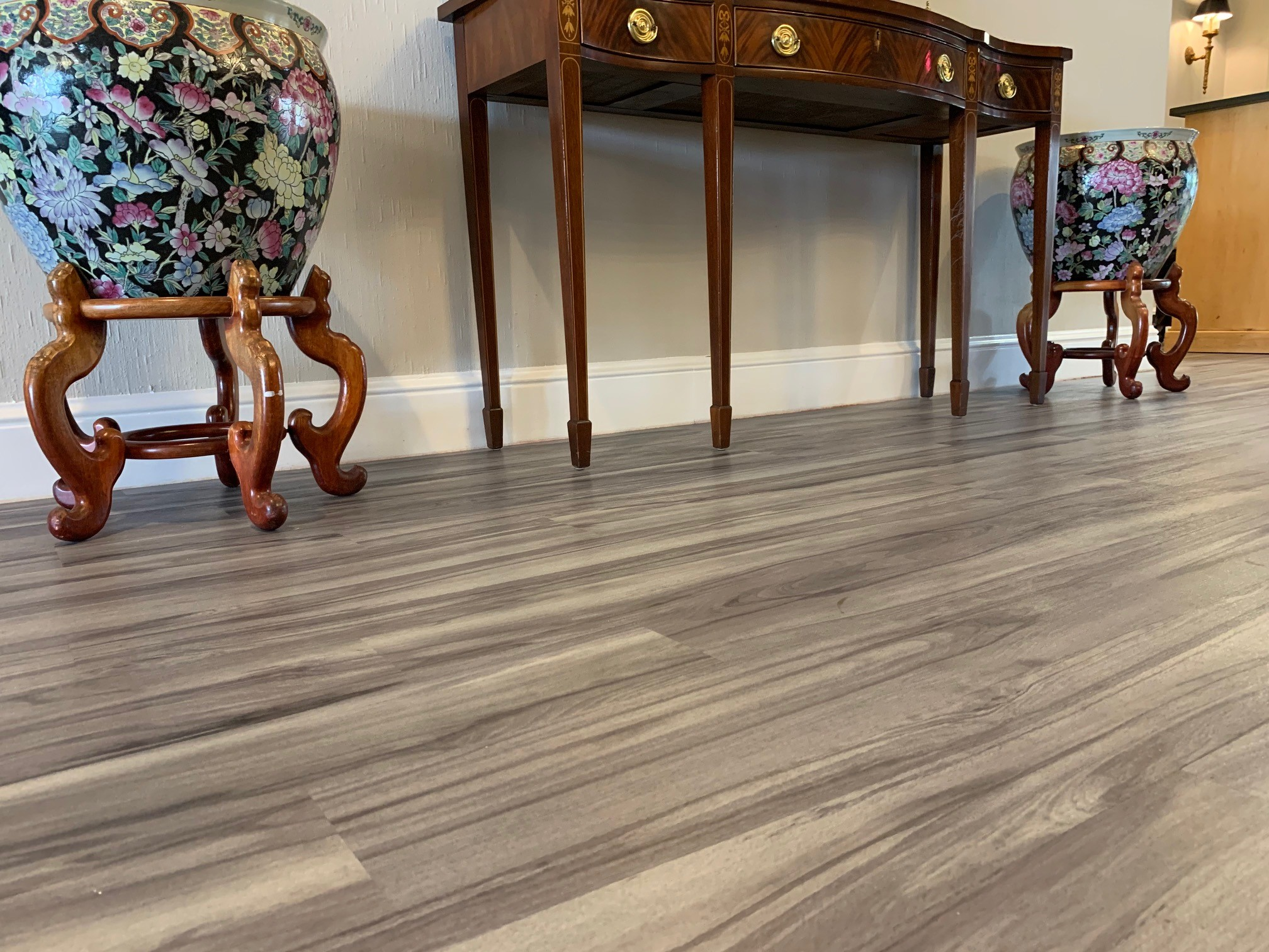 Flooring near a table and two vases