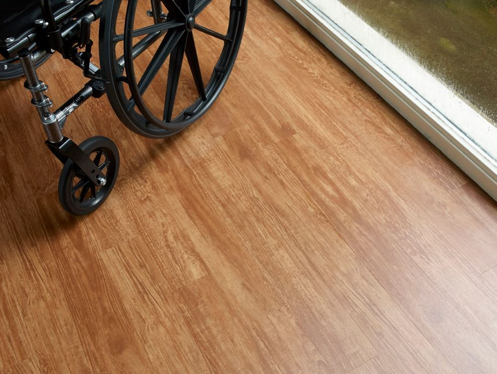 Image of part of a wheelchair on top of floor