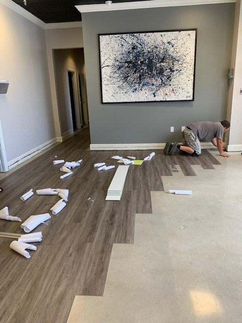 Man laying SetaGrip flooring for Certified Finishes