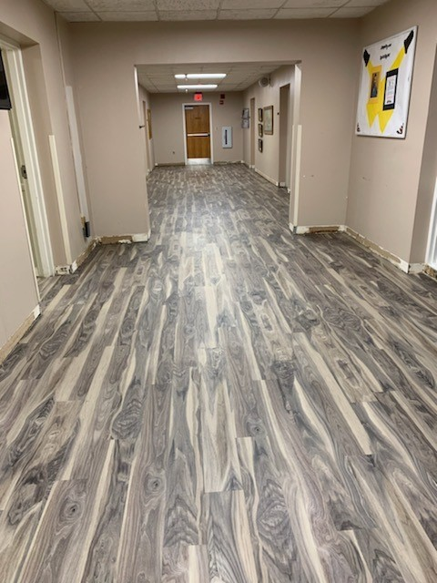 Hallway in building with wood grain floors