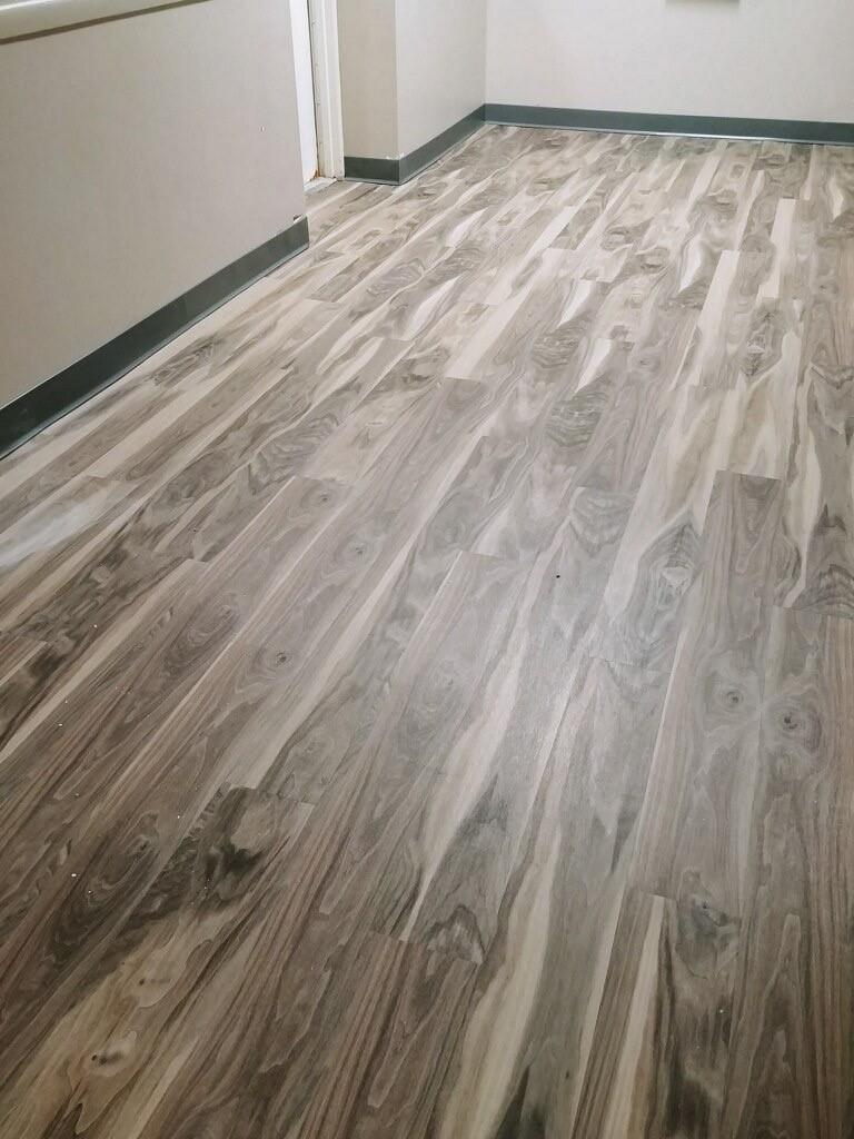Hallway in building with wood grain floor
