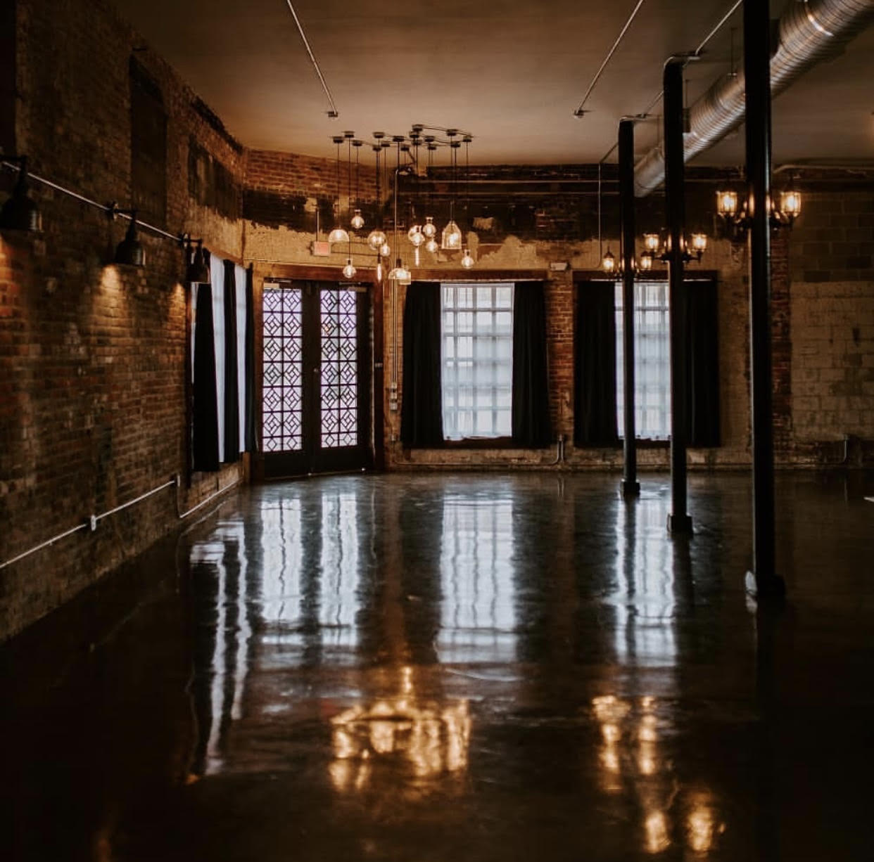 Large room with glossy concrete floors and lighting
