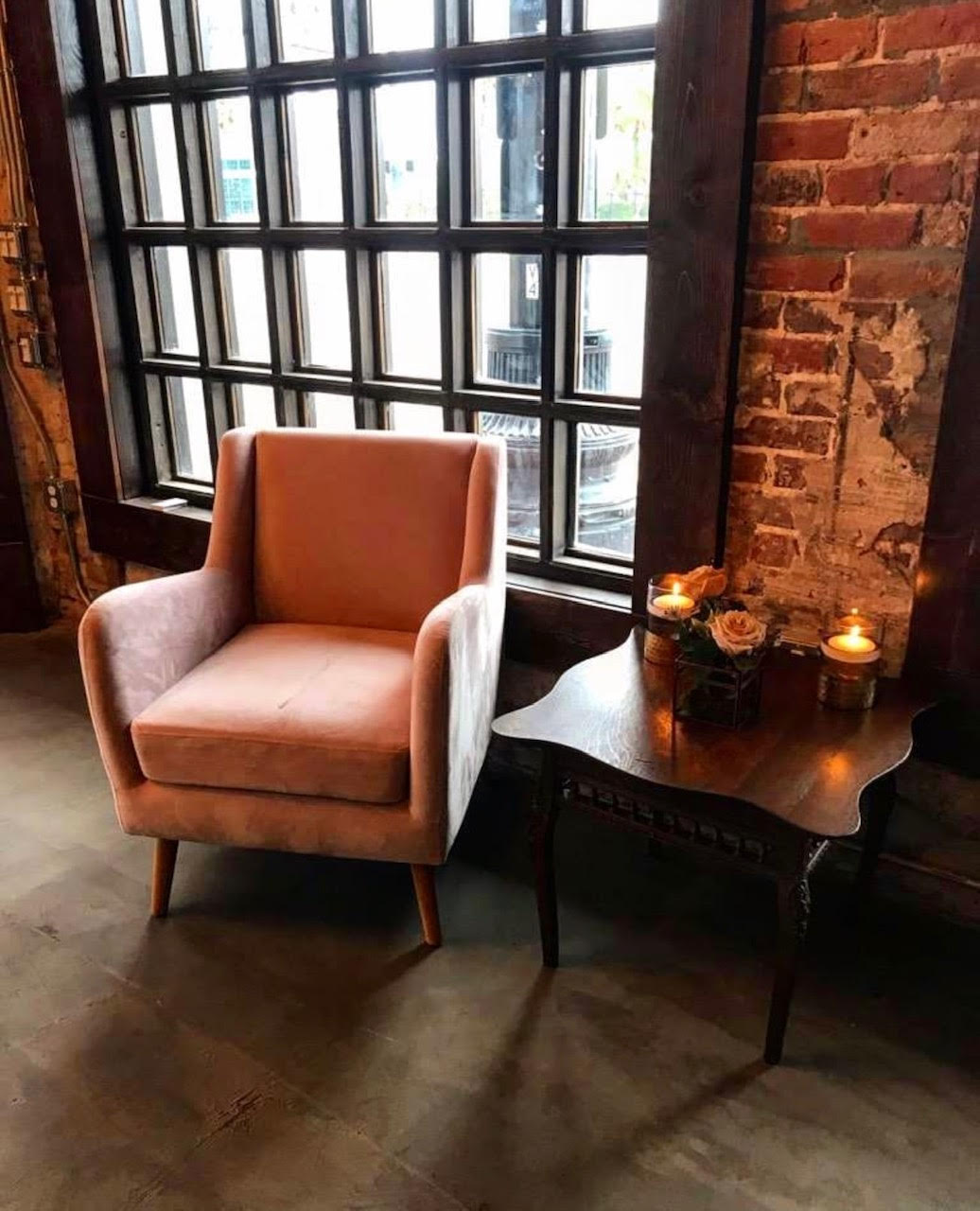 Pretty chair by windows and a table