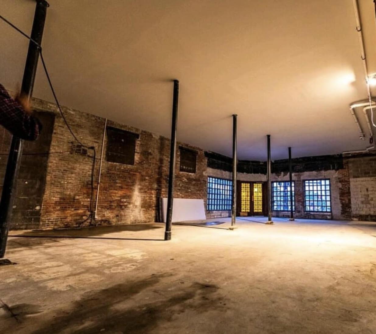 Empty room with brick walls and concrete floor